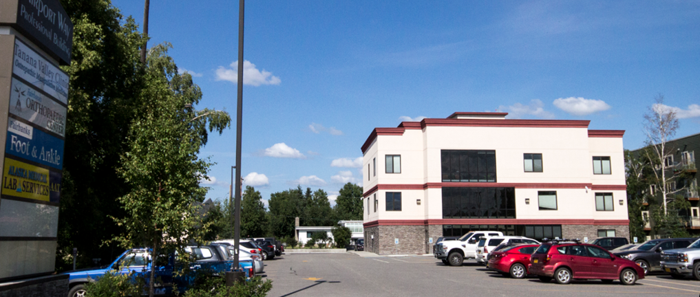 photo of office building and parking lot